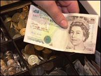 Money being put into a cash register
