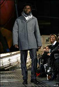 A Senegalese illegal immigrant models clothes for Antonio Miro in Barcelona