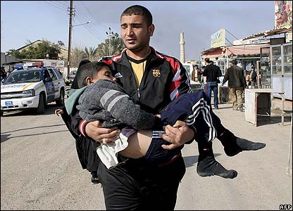 Baghdad bombings - Jan 22 2007 - some carry relatives to hospital - AFP photo