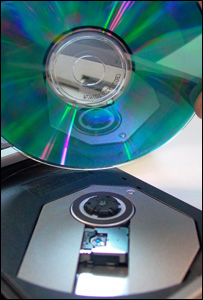 CD being placed in drive, BBC