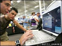 Men look at laptop