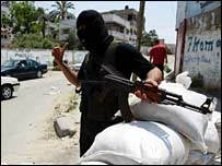 A gunman maintaining a position in Gaza City