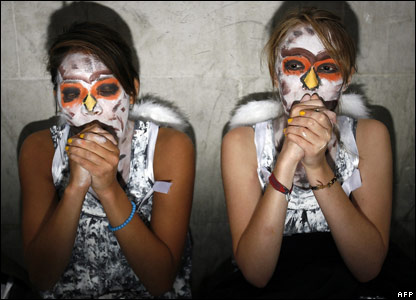 Two young women dressed up as owls