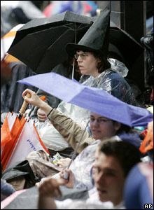 Fans waiting in the rain, dressed up as witches