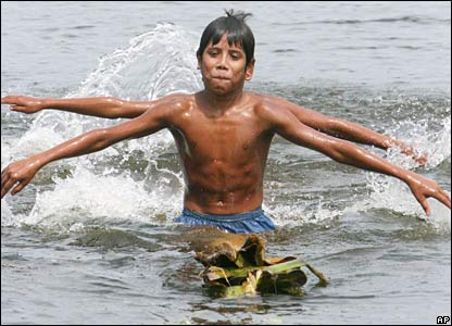 Boys play in floodwaters in Sirajganj, Bangladesh.