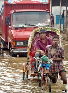 Cycle rickshaw in flooded street in Dhaka