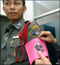A police officer wears a pink armband featuring 'Hello Kitty