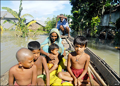 Villagers navigate through floodwaters in the Aricha district of Dhaka, Bangladesh