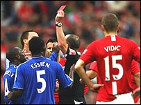 Chelsea players surround ref