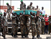 AU troops carry the coffin of a soldier killed in the recent attack