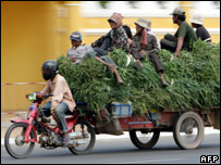 A Cambodian motor-cart loaded with grass and people in Phnom Penh (file photo)