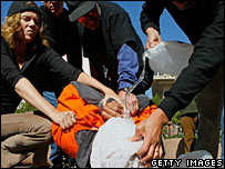 Protest showing water-boarding technique