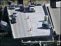 Mississippi road bridge falling into river