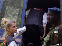 Emilie Lelouche, one of the six, getting into a police truck