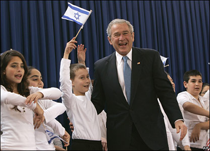 President Bush greets a group of children who performed a song upon his arrival at the residence of Israeli President Shimon Peres, Wednesday, 9 January 2008, in Jerusalem