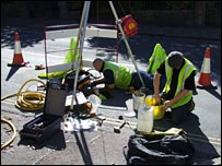 Men laying fibre in sewers