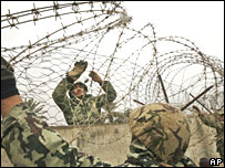 Egyptian forces place barbed wire in a breached section of the border wall between Egypt and Rafah on 29 January 2008