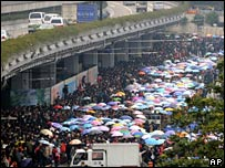 Travellers wait outside Guangzhou station on 29 January 2008