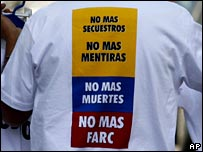 man wearing 'No More Farc' t-shirt