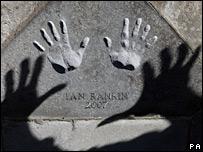 Ian Rankin's handprints in the Caithness stone at Edinburgh City Chambers