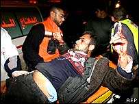 Palestinian health workers wheel a wounded Palestinian to a hospital in Beit Lahia.