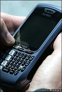 Blackberry user checking his e-mails