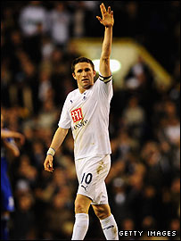 Robbie Keane salutes the Spurs fans after his late goal against Chelsea