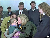 Hillary Clinton greets a little girl at Tuzla air base