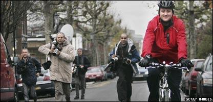 Press follow David Cameron as he cycles in London