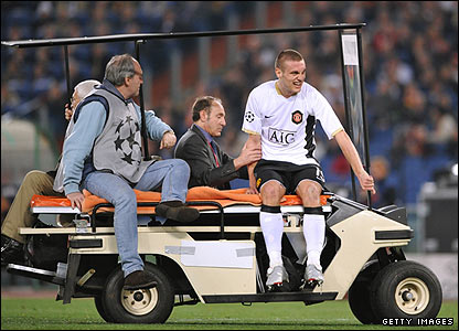 United's Nemanja Vidic is forced off in the 33rd minute
