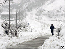 Villager walks through the snow in Nanjing, China (February 2008)