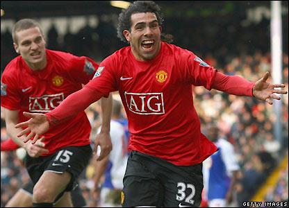 Tevez celebrates his equaliser