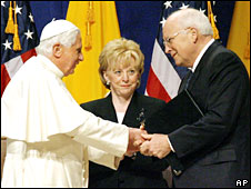 The Pope says farewell to Dick Cheney as wife Lynne Cheney looks on at New York's JFK airport on 20 April 2008