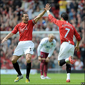 Rio Ferdinand celebrates with Ronaldo