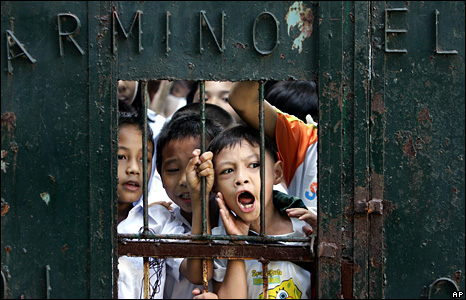 Pupils at Belarmino Elementary School in Manila demand that their teachers come back to teach them