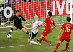 Bastian Schweinsteiger scores the opener for Germany