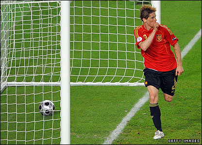 Torres celebrates after scoring for Spain