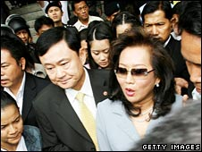 Former PM Thaksin Shinawatra and his wife Pojaman leave Bangkok's Criminal Court on Thursday