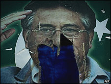 Photo of Pakistani President Pervez Musharraf seen partially torn down on outskirts of Islamabad