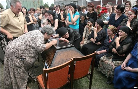 Friends and relatives cry over the coffin of an ethnic Ossetian in Nogir, North Ossetia