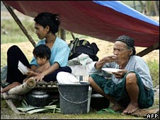 A family sit at an evacuation centre in Pikit town on 13 August 2008