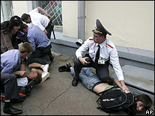 Belarussian police arrest demonstrators outside the Russian embassy on 11 August