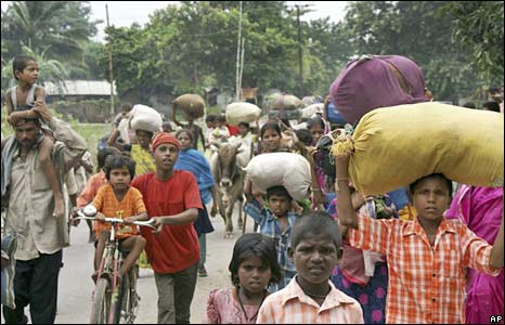 People in Bihar move with their belongings to relief camps