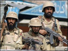 Pakistani paramilitary troops patrol streets in Jamdrud, an area of Pakistan's Khyber tribal region, Sunday, Aug. 31, 2008.