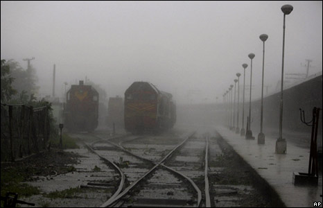 Trains sit at a station hit by heavy rain in Camaguey on 8 September 2008
