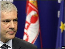 Serbian President Boris Tadic, with Serbian and EU flags