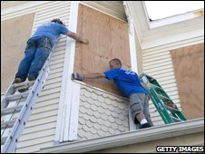 Men board up a house in Galveston, Texas (11/09/2008)