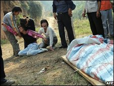 Family members grieve for one of the victims on 12 September 2008