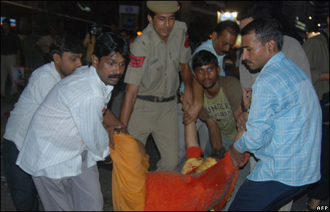 A victim of the blast is carried away
