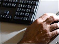 Man using computer, PA